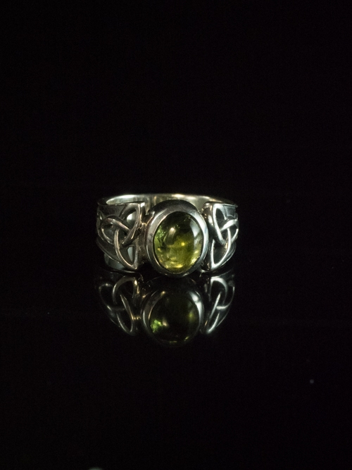 Celtic Trinity Knot Ring With Oval Peridot
