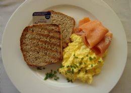 Deluxe breakfast-Smoked trout on homemade bran and poppy seed crumpets with scrambled eggs.
