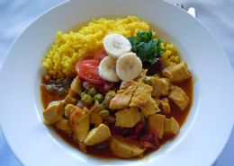Chicken Curry served with turmeric rice, organic banana, chutney & coriander